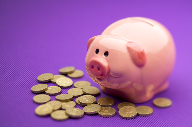 Pink Piggy bank with pound coins